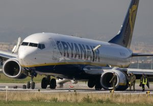 Ryanair jet lies on the runway with collapsed landing gear after an emergency landing at Ciampino airport in Rome