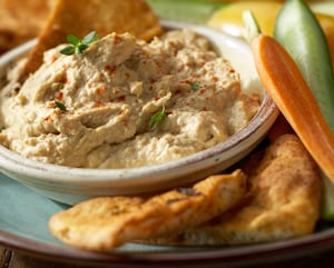 Simple and delicious.  The homemade pita chips make this recipe even better!