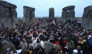 Crowds gather at dawn amongst the stones at Stonehenge in Wiltshire for the Summer Solstice. PRESS ASSOCIATION Photo. Picture date: Friday June 21, 2013. More than 20,000 people celebrated the summer solstice at Stonehenge ahead of the £27 million transformation of the site. See PA story HERITAGE Stonehenge. Photo credit should read: Lewis Whyld/PA Wire